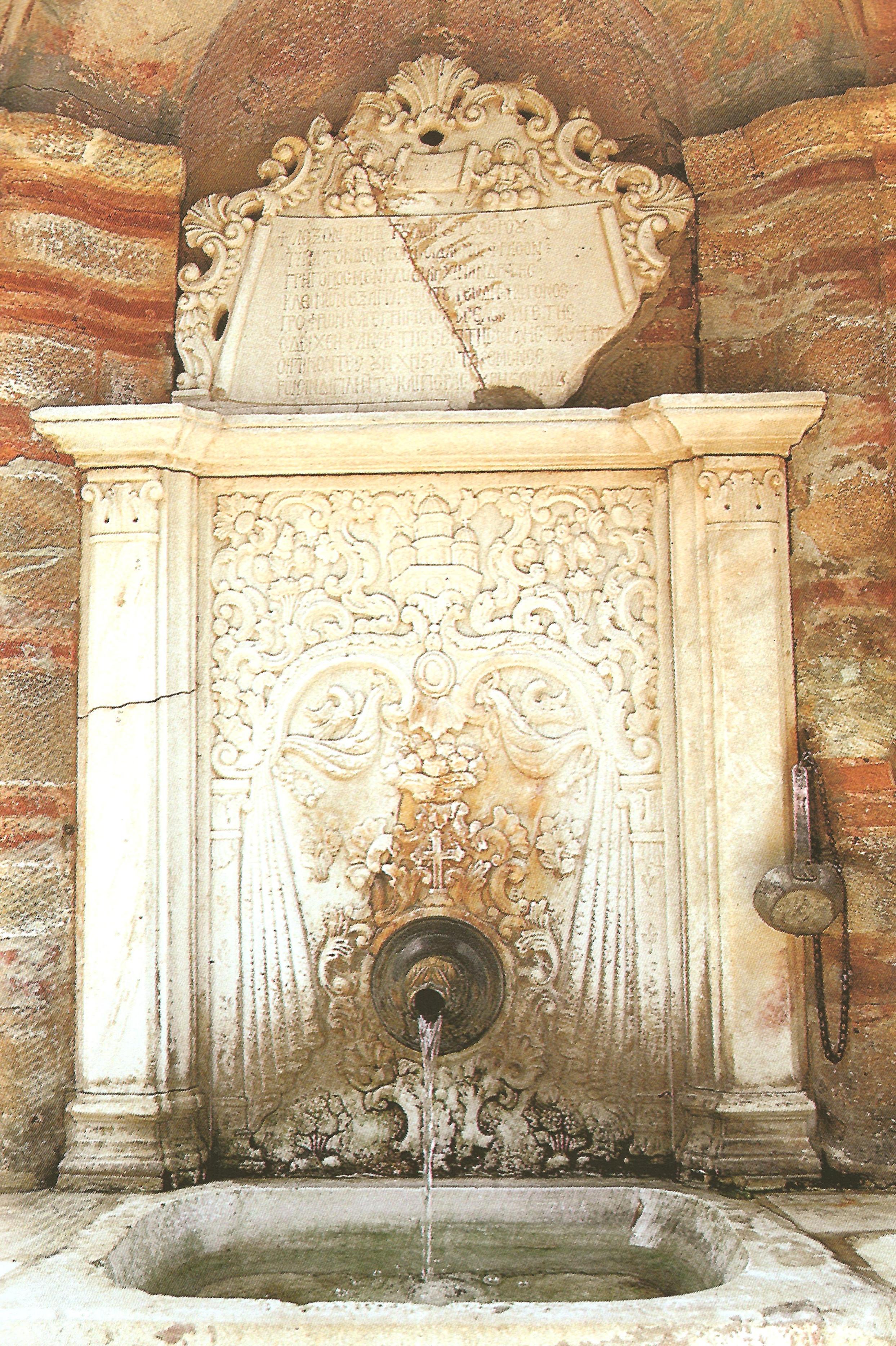 Η κρήνη απέναντι από την είσοδο της Μονής (18ος αι.). The 18th century fountain opposite the monastery gate