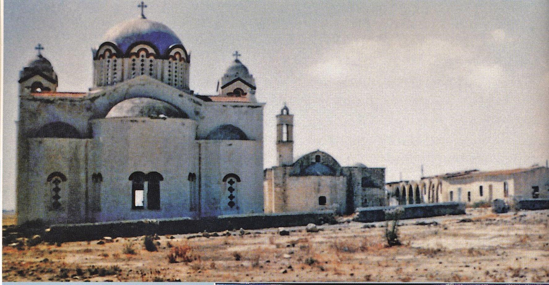 Η καινούρια και η παλιά μοναστηριακή εκκλησία του Αγίου Αναστασίου. Στη βόρεια πλευρά της παλιάς εκκλησίας διακρίνονται δύο καμάρες του μοναστηριού. Η παλιά μοναστηριακή εκκλησία, όπως αναφερόταν σε επιγραφή που βρισκόταν μέχρι το 1974 πάνω από την νότια θύρα, κτίστηκε εκ βάθρων το 1755 με δαπάνες του ομοχωρίου Αγίου Παναρέτου και των κατοίκων. Η νέα εκκλησία κτίστηκε το 1952. Μετά την τουρκική εισβολή και οι δύο εκκλησίες, αφού συλήθηκαν, βεβηλώθηκαν και χρησιμοποιήθηκαν ως στάβλοι, υπέστησαν με την πάροδο του χρόνου σοβαρές ζημιές, οι οποίες δυστυχώς γίνονται ολοένα και σοβαρότερες, ένεκα της συνεχιζόμενης τουρκικής κατοχής.