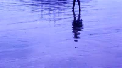 girl walking sea