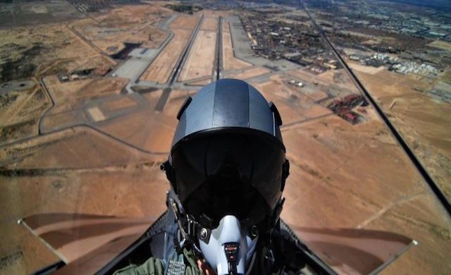 U.S. Air Force Airman 1st Class Matthew Bruch, an aerial photographer with 1st Combat Camera Squadron, takes a self portrait during a flight in an F-15D from the 65th Aggressor Squadron flying in support of the Air Force Weapons School over Nellis Air Force Base, Nev., May 17, 2012. The Air Force Weapons School is a five-and-a-half-month training course which provides selected officers with the most advanced training in weapons and tactics employment. Throughout the course, students receive an average of 400 hours of post graduate-level academics and participate in demanding combat training missions.